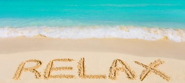 bigstock-Word-Relax-On-Beach-50760366707
